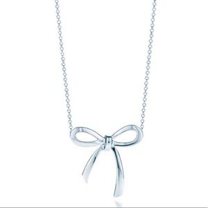 Authentic Tiffany & Co. bow pendent.